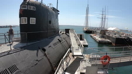 navy pier : San Diego, Navy Pier, California, USA - August 1, 2018: CCCP Soviet Submarine B-39 with Soviet Union Red star at San Diego Navy Pier in United States. Open for visits inside and outside.