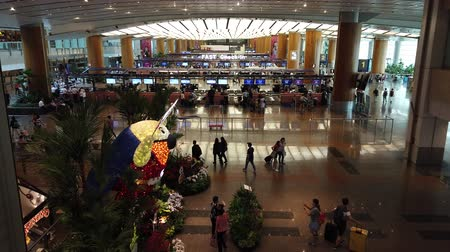 menetrend : Singapore - Aug 8, 2019: interior lobby and escalator of new Jewel Changi International Airport opened in April 2019. People traveling to the terminal for departure. Stock mozgókép