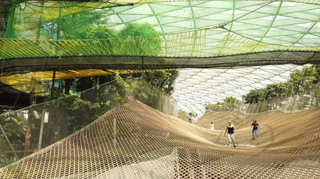 drágakő : Singapore - Aug 8, 2019: Manulife Sky Nets Bouncing the most fun attraction in Canopy Park in Jewel Changi Airport, a nature-themed with gardens, attractions, retail and restaurants, opened in 2019.