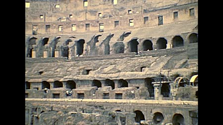 flavian : ROME, ITALY - circa 1986: the Roman coliseum interior, the largest amphitheater in the world and one of the symbol of Rome city. Historical archival of Rome capital of Italy in the 1980s.