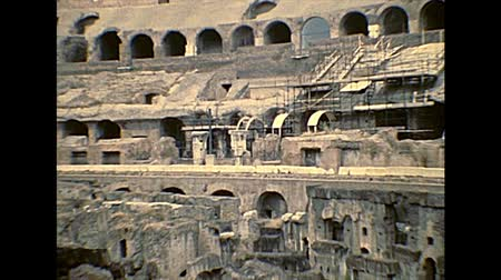 flavian : ROME, ITALY - circa 1986: Rome coliseum interior panorama, the colosseo is the largest amphitheater in the world of Rome. Historical archival of Rome capital of Italy in the 1980s.