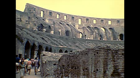 amphitheatrum : ROME, ITALY - circa 1986: Rome coliseum interior with tourists, the biggest landmark of Italy and Rome. Historical archival of Rome capital of Italy in the 1980s.