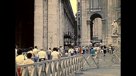 hacı : ROME, ITALY - circa 1986: crowd of people on pilgrimage in Saint Peter square. Visiting Saint Peter church for public speaking of old Pope John Paul II. Archival of Rome city of Italy in the 1980s.