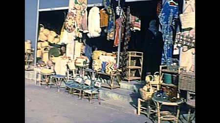 archívum : Haifa, ISRAEL - CIRCA 1979: Shops on the street with traditional clothes and handmade furniture. Historical archival footage in the 1970s of Israel.