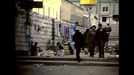 homeopático : Nazareth, ISRAEL - CIRCA 1979: Nazareth road life with stores and street markets. Local people in typical traditional dress and vintage houses. Archival footage in the 1970s of Israel.