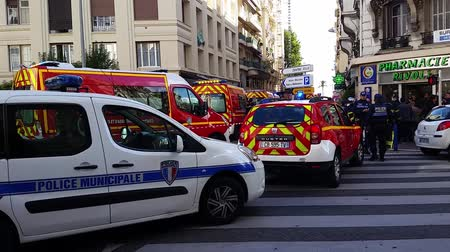 mobilization : Nice, France - October 16 2015: French Police officers and Firefighters at Building Fire. Emergency Vehicles in the Streets of Nice (French Riviera) in France