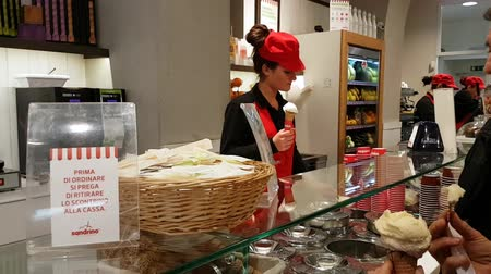prepaid : San Remo, Italy - March June 2017: Traditional Female Vendor Prepares A Lemon Ice Cream Cone In The Ice Cream Shop In San Remo, Italy