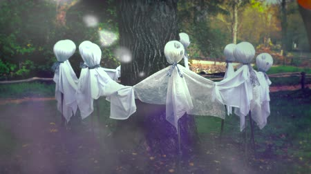 temor : Scary Ghosts Around a Tree, Ghost Circle Yard Halloween Decoration - HD Video Stock Footage