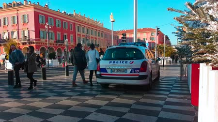 por que : Nice, France - December 5, 2017: French Police Car Peugeot 308 HDI SW 1.6 (Rear View) Parked on Place  in Nice, French Riviera - 4K Video