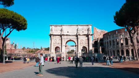 costantino : Rome, Italy - February 10, 2018: Hyperlapse - Timelapse of Arch of Constantine, Triumphal Arch in Rome and Colosseum in The Background - 4K Video