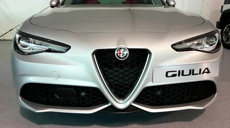 хром : Monte Carlo, Monaco - February 18, 2018: Close Up Alfa Romeo Badge. White Alfa Romeo Giulia Front Grill And Headlights on Display During The Siam 2018 (Monaco Motor Show) - 4K Video