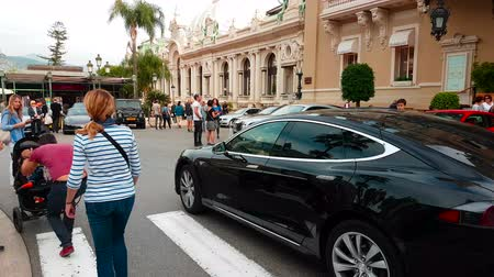 tesla model s : Monte-Carlo, Monaco - October 28, 2017: Man Driving An Expensive Black Tesla Model S in Front of the Monte-Carlo Casino in Monaco in The French Riviera - 4K Video