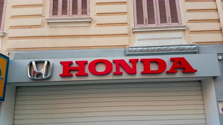 хром : Monte-Carlo, Monaco - February 18, 2018: Honda Company Logo on the Wall of a Shop. Honda is a Japanese Public Multinational Conglomerate Corporation Known as a Manufacturer of Automobiles, Motorcycles, Robots, Aircraft, And Power Equipment - 4K Video