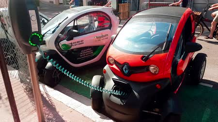 recharging : Monte-Carlo, Monaco - April 21, 2018: French Mini Renault Twizy Electric Charging Car On Street in Monaco - 4K Video