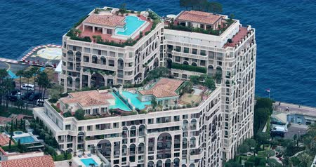backround : Fontvieille, Monaco - May 18, 2018: Aerial View of Luxurious Apartments With Rooftop Pool Located in the Fontvieille District, Principality of Monaco, French Riviera, Europe - DCi 4K Resolution