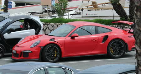 por que : San Remo, Italy - June 10, 2018: Beautiful Red Porsche 911 GT3 RS (Side View) Parked In The Street Of The City Center Of San Remo, Liguria, Italy - 4K Video