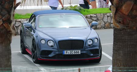 por que : San Remo, Italy - June 10, 2018: Luxurious Bentley Continental GT Convertible Parked In A Public Car Park In San Remo, Liguria Italy, Europe - 4K Video