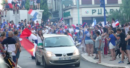 jogador de futebol : Menton, France - July 15, 2018: 2018 FIFA World Cup Russia: France Celebrate In Menton Supporters After Winning The World Cup With 4-2 Victory Over Croatia - DCi 4K Resolution Stock Footage