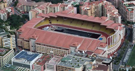 como : Fontvieille, Monaco - May 18, 2018: Beautiful Aerial View Of The Louis II Stadium, Home Of AS Monaco And The Monaco National Football Team And Fontvieille District In Monaco, South Of France - DCi 4K Resolution