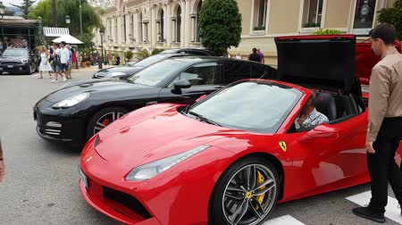 roadster : Monte-Carlo, Monaco - September 23, 2018: Ferrari 488 Spider Opening The Roof In Front Of The Monte-Carlo Casino In Monaco In The French Riviera, Europe - 4K Video