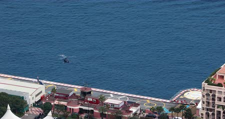takeoff area : Fontvieille, Monaco - May 18, 2018: Aerial View Of Helicopters Helicopter Heliport, Heli Air Monaco, French Riviera, Europe - DCi 4K Video