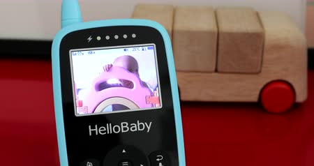 infante : Paris, France - November 18, 2018: Happy Baby Boy With Baby Monitor In Home, Hello Baby HB24 Baby Monitor, Close Up View - DCi 4K Resolution