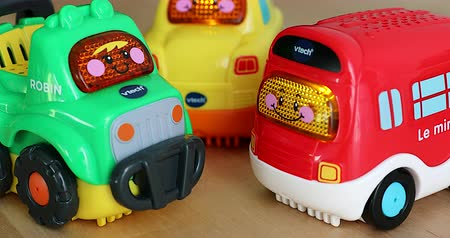 minibus : Menton, France - December 10, 2018: Funny Multicolor Plastic Toy Cars For Babies With Lights and Sounds. VTech Go! Go! Smart Wheels Car. Close Up View DCi 4K Resolution