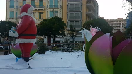 Menton, France - December 14, 2018: Sculpture Of Santa Claus And Decorations Of Christmas In A Public Square Biov?s Gardens In The City Of Menton Municipality, Alpes-Maritimes, France, Europe - 4K Resolution
