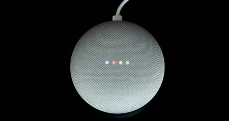 Paris, France - December 17, 2018: Overhead View Of A Google Home With Mini Cable (Chalk Color), Black Background. Smart Speaker With The Google Assistant, Virtual Assistant Powered by Artificial Intelligence - DCi 4K Resolution