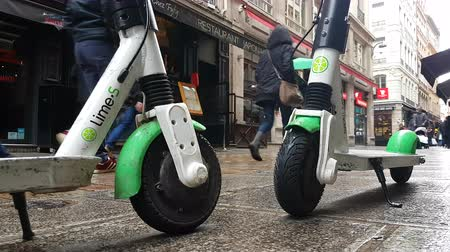 electric vehicle : Lyon, France - January 4, 2019: Two Lime-S Electric Rental Scooter Parked In Merciere Street Street In Lyon, France, Europe - 4K Resolution