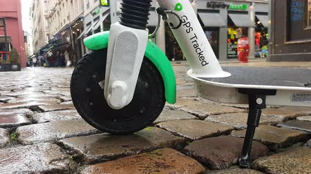 tracked : Lyon, France - January 4, 2019: Lime-S Electric Rental Scooter Parked In Merciere Street Street In Lyon, France, Europe - 4K Resolution Stock Footage