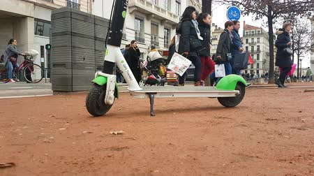 tracked : Lyon, France - January 4, 2019: Lime-S Electric Rental Parked Scooter On Place Bellecour In Lyon, France, Europe - 4K Resolution