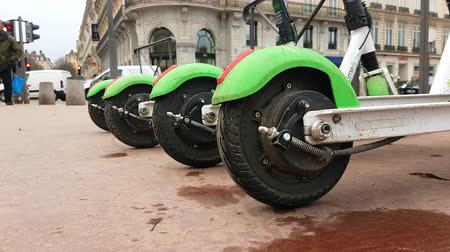 tracked : Lyon, France - January 4, 2019: Four Lime-S Electric Rental Scooter Parked On Place Bellecour In Lyon, France, Europe - 4K Resolution Stock Footage