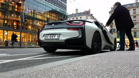 Lyon, France - January 4, 2019: White BMW i8 Plug-In Hybrid Sport Car (Rear View), Man Closing The Door. Supercar Parked In The Street In Lyon, France, Europe - 4K Resolution