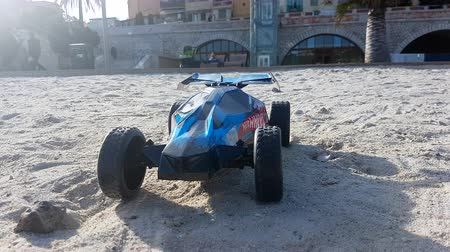 buggy car : Menton, France - January 13, 2019: Radio Controlled Hot Wheels RC Gator Buggy. Off Road Buggy On The Beach Sand In Menton France On The French Riviera, Europe - 4K Resolution