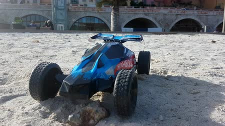 Menton, France - January 13, 2019: Radio Controlled Hot Wheels RC Gator Buggy. Off Road Buggy On The Beach Sand In Menton France On The French Riviera, Europe - 4K Resolution