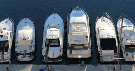 Fontvieille, Monaco - January 15, 2019: Top View Of Luxurious Yachts And Megayachts Lined Up, Moored Sailboats In The Port Of Fontvieille In Monaco, French Riviera, Europe - DCi 4K Video Dostupné videozáznamy