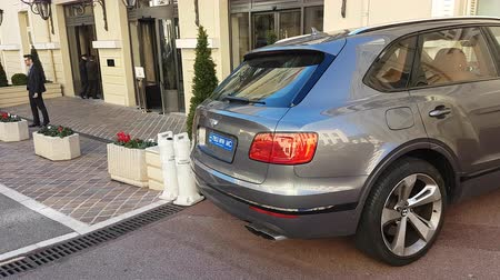 Monte Carlo, Monaco - January 25, 2019: Luxury Bentley Bentayga SUV (Rear View) Parked In The Street Of Monaco. French Riviera, Europe - 4K Video