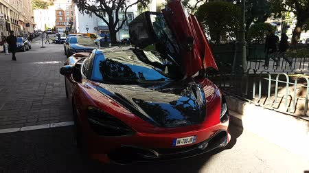 super car : Monte-Carlo, Monaco - January 25, 2019: Beautiful Red McLaren 720S Supercar, Doors Up, Parked In Front Of The Hermitage Hotel Monte-Carlo In Monaco. French Riviera, Europe - 4K Video