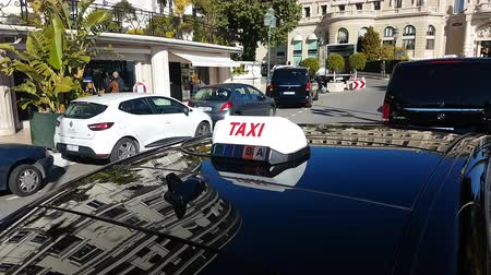 por que : Monte Carlo, Monaco - January 25, 2019: French Taxi Sign On Car Roof. Luxury Vehicle Parked In The Street Of Monaco. French Riviera, France, Europe - 4K Video
