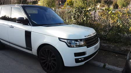 Roquebrune-Cap-Martin, France - January 25, 2019: Luxury White Land Rover SUV Range Rover Parked In The Street. French Riviera, Europe - 4K Video Dostupné videozáznamy