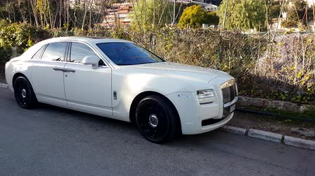 por que : Roquebrune-Cap-Martin, France - January 25, 2019: Luxury White Rolls-Royce Ghost Parked In The Street. French Riviera, Europe - 4K Video