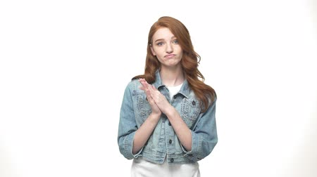 idéia genial : Beautiful young unhappy clap hands while standing isolated on white