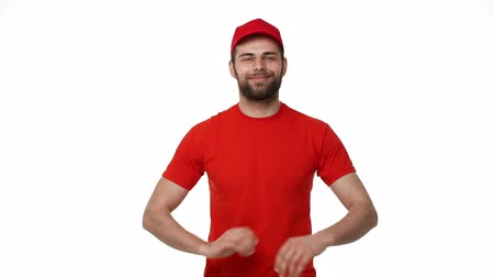 professionalism : handsome male service industry worker deliveryman in uniform posing on white background with arms crossed confidence professionalism career employment concept. Stock Footage