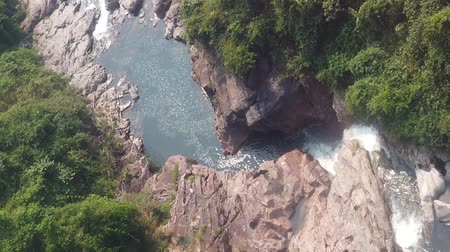 tiered : Top down aerial view of giant waterfall flowing in Vietnam mountains filmed in slow motion