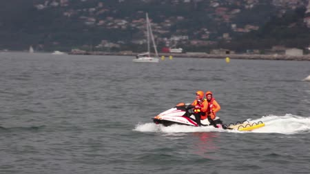 pwc : TRIESTE, ITALY - OCTOBER 12: Italian Firemans on personal water craft in the sea Trieste, northern part of the Adriatic Sea on October 12, 2014
