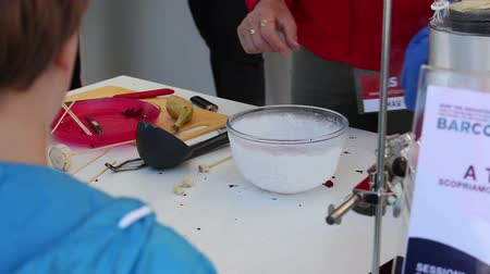Teacher conducting an experiment with liquid nitrogen