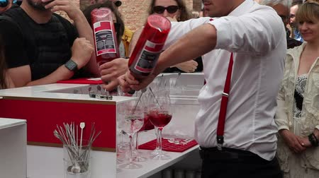 barman : VENICE, ITALY - MAY 10: Barman preparing spritz during the Venice Biennale on May 10, 2019