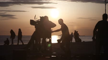 kino : TRIESTE, ITALY - APRIL, 17: Behind the scene. Movie crew crew filming movie scenes on outdoor location at sunset on April 17, 2018