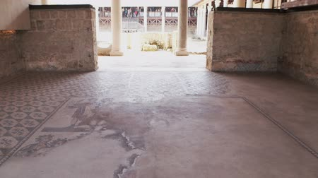 régészet : PIAZZA ARMERINA, ITALY - APRIL, 24: Mosaics of the Roman Villa at the Casale, large and elaborate Roman villa designated as a UNESCO World Heritage Site, famous for the extraordinary collection of frescoes and mosaics on April 24
